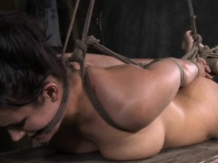 Hogtied submissive in bastinado session